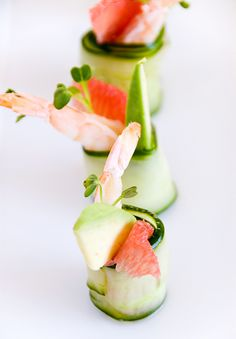Cucumber Shrimp Rolls  1 English cucumber  1/2 cup rice wine vinegar  3 tbsps sugar  1 ripe avocado  1 pink grapefruit  1/2 lb. raw medium shrimp, peeled and deveined (leave tails if desired)  daikon sprouts (optional)  18 skewers