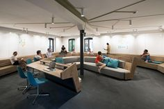 Millwork benches in a large conference room- New Soundcloud Headquarters / KINZO Berlin