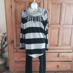 French Laundry Striped Cowl Neck Sweater French Laundry Striped Cowl Neck Tunic, with fringe around collar. Looks great with black leggings and boots. Very soft light weight polyester spandex blend. Never worn, brand new condition. French Laundry Sweaters Cowl & Turtlenecks