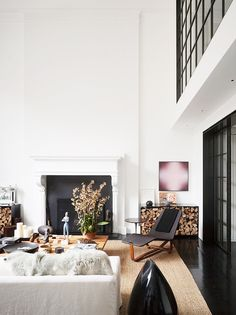 Step Inside a Soaring New York Home//fireplace, chaise, fur blanket, jute rug, coffee table styling