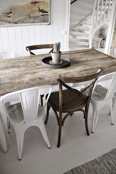 Metal and wood chairs with a rustic table