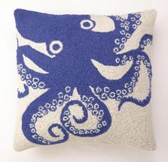 A royal blue octopus image on a cream wool hooked background, makes up this fun overstuffed beach house pillow.