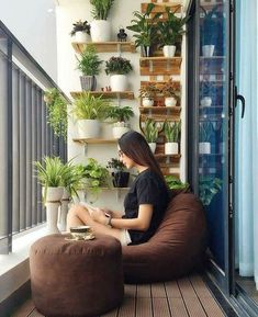 Apartment Balcony Decorating Apartment Balconies Apartment Ideas Small Living Room Design Small Living Rooms Living Room Designs Balcony Plants Balcony Design Watering Cans