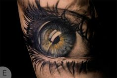 This hyper-realistic tattoo is just awesome! That sheen!