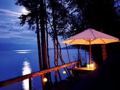 Outdoor Deck  Summer nights are made for moonlight and magic. This enchanting scene, overlooking Montana's Flathead Lake, features portable lanterns with metal handles hanging from hooks in the deck railing.