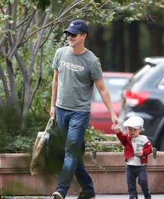 Doting dad: Edward Norton showed how gentle he can be as he took his then 17-month-old son Atlas