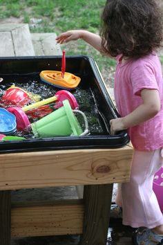 this is the best DIY water table i have seen. no instructions, but any handman or man with a hammer should be able to replicate this design. perfect for that empty space underneath our playset!