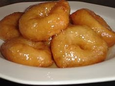 Loukoumades - Those of you who have eaten loukoumades will know what a delicious treat they are! There are cafes here that serve them and you can just walk in off the street and order a plateful of them to eat. However, home made loukoumades are much cleaner and tastier. They are ideally eaten as they are made - nice and warm with the syrup all over them!