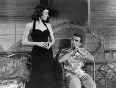 'American actress Donna Reed, born Donnabelle Mullenger, Oscar-awarded as Best Supporting Actress for her performance as Alma Burke, wearing an elegant black dress, stares at the American actor Montgomery Clift, sitting nearby, in a scene from Fred Zinnemann's From Here to Eternity. USA, 1953. (Photo by Mondadori Portfolio via Getty Images)'