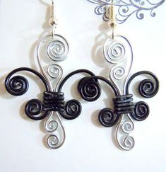 Fleur de lis earrings but would be a cute necklace too