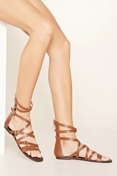 Style Deals - A pair of faux leather sandals with a crisscross strappy design, high-polish buckles, and an exposed back zipper. #stepitup