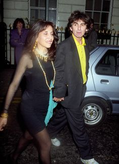 "That Eventuality Olivia and George Harrison, photographed on the occasion of Michael Caine's birthday celebration, 14 March 1990 ""[H]is dark sweet lady was the love of his life, and I know how much he loved her; a braver, finer, lovelier companion no man could ever find, and it breaks my heart to think of these last […] years."" - Eric Idle on George and Olivia Harrison, The Greedy Bastard Diary [x]"