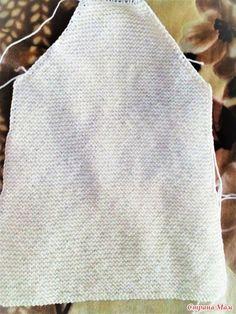 Вязанное пальто спицами