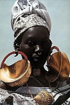 fulani horsemen | fulani people western africa woman with large gold earrings 20th ...