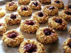 Walnut and jam thumbprint cookies - laura laurentiu Cookie Recipes, Dessert Recipes, Desserts, Jam Thumbprint Cookies, Romanian Food, Cake Shop, Food Cakes, Sweet Cakes, Christmas Baking