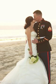 Marine Corps beach styled wedding✔️ I want this so bad but I'd be the one in the uniform(:
