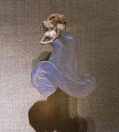 """Lalique 1901 'Two Women Dancing' Pendant: glass/ivory/ gold/enamel. Signed & dated """"LALIQUE 1901"""" on the reverse: acquired from the artist in 1901: two intertwined female figures, their heads & torsos of carved ivory, their swirling skirts of opalescent molded blue glass flecked w/gold: museo.gulbenkian.pt"""