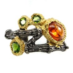 Handmade 8x6mm Spessartite Garnet Chrome Diopside 925 Sterling Silver Ring Sz 8           PRODUCT TYPE    RING           TYPE OF METAL    925 STERLING SILVER          PLATE    2-TONE BLACK RHODIUM & YELLOW 14K GOLD           RING SIZE/LENGTH (INCHES)    8