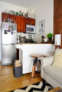 [Kitchen cabinet on wheels!] Use a chef's cart to double the counter and storage space in your itty-bitty kitchen.
