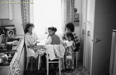Family in Moss Side, Sept 1974 by mcrarchives, via Flickr