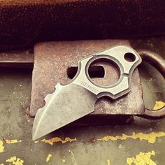 Crow's Head Neck Knife. This tiny knife is meant to either be carried around your neck or on your keys. It will come with a tiny Kydex sheath. The goal price wise would be to keep it under $100.