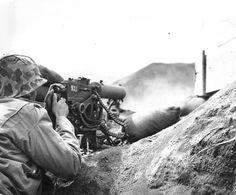 Marine firing a Browning M1917 machine gun on Iwo Jima, February, 1945.