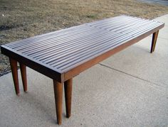 "1950's-60's era Danish modern expandable slat table/bench. Made of hardwood, very heavy. Most likely European made. Measures 18"" x 55-1/2"" by 12"" tall. Expands to 97"". Could use refinishing, no major damage, just average wear. I applied a little oil, Old English scratch cover for dark wood will help greatly."