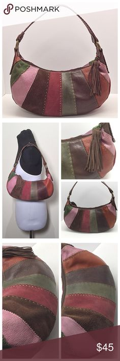 """Fossil 1954 Vintage Suede Hobo 🚫Trades/Holds🚫 Fossil Boho Hobo -MORE PICS 2ND LISTING! *  Suede/leather panels w/ rivet & stitched trim *  Brass tone hardware *  Suede fringe zipper pull *  Wide, whipstitched strap w/ 10"""" drop *  Brown lining w/ logo patch, zip + 2 slip pockets *  About 13"""" x 7 x 4.5 *  Pre-loved, no marks on lining, panels have some slightly darkened areas, strap shows wear but I think it makes it look more saddle-like, 1 missing rivet Plz ask ?s if unsure of condition or…"""