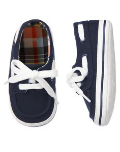 Nautical spring style for his feet. Made from brushed cotton canvas, our fashionable crib boat shoe features a comfy lace-up design with grommets.