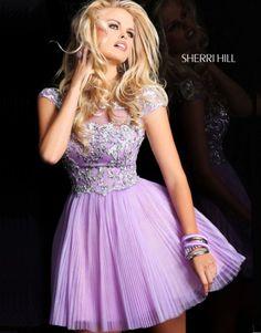 This beautiful short, light purple Sherri Hill prom dress is a perfect