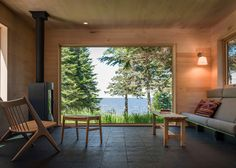 Timber gallery hovers above the veranda of a lakeside retreat.