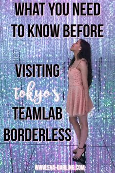 Travel and style blogger Eva Phan of Eva Darling on what you need to know before going to TeamLab Borderless at the Mori Digital Art Museum in Tokyo Japan long brown curled hair solo female travel stiletto shoes