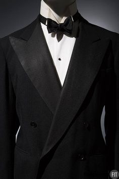 """Man's tuxedo by Persall Tailors, 1936. Collection of The Museum at FIT.  During the 1930s, a traditional black tuxedo—such as this elegant custom example from a highly regarded New York tailor—was not considered appropriate for formal events. For those occasions, a gentleman would wear white tie and a tailcoat. A 1934 New York Times article reported the advice of industry insiders: """"Don't wear a tuxedo except in the home, club or at stag affairs."""""""