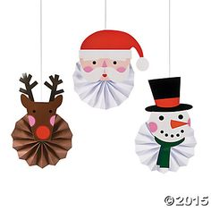 Make Christmas decorations cheerier by adding images of reindeer, Santa and snowmen to the mix. These Christmas Character Hanging Fans add instant Chr. Christmas Arts And Crafts, Holiday Crafts For Kids, Christmas Activities, Xmas Crafts, Kids Christmas, Christmas Ceiling Decorations, Large Christmas Baubles, Christmas Ornaments, Christmas Classroom Door