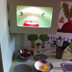 Microwave and Oven lights from Ikea - Push on/off ones - stuck with a sticky pad to the roof of each.