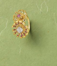 Tanishq Zyra collection yellow gold lily drop earrings outlined in brilliant-cut diamonds.