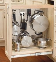 rv storage ideas | RV Travel Tips * My little house came with a slide out cabinet with shelves. Converting this cabinet for pots and pans is very much an appealing option.