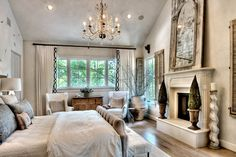 Wow.  Gorgeous master bedroom with white, cream, and metallic accents.