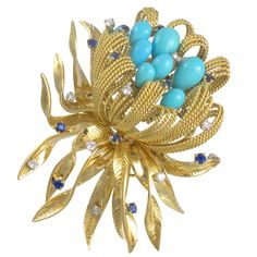 1960's French Gold and Turquoise Flower Brooch.18K yellow gold, turquoise, sapphire and diamonds. Circa 1960s