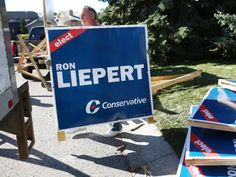 Former Alberta cabinet minister Ron Liepert, cleans up his signs in Calgary on Tuesday after his victory in Signall Hill.