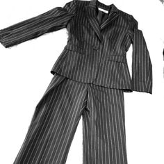 Tahari Arthur Levine business suit Jacket -- Black suit with silver stripes. Front button  closure, long sleeves with two faux pockets. Pants -- Zip fly with hook-bar closure, two back pockets, trouser leg. This set originally had three pieces, the third piece is missing... The price shows. Tahari Other
