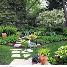 Three easy ways to highlight your shade garden. Pavers continue through grass & mulch to create cohesion.