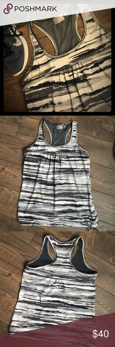 ATHLETA Tank Great street to the gym tank from Athleta. Quik-Dry material. Draw string hem line. Built in shelf bra. EUC! Athleta Tops Tank Tops