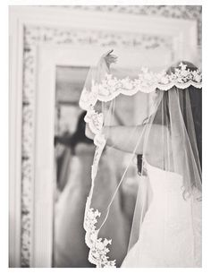 I want a veil that has the cute embroidered lace stuff on the edge...kinda like Whitney's was!