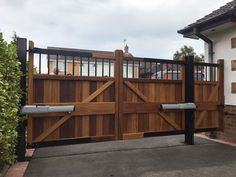 Electric driveway gates in hardwood iroko. Centre brace increased to allow stability and durability. Above ground automation system used with the gate mounted on metal posts. Metal Garden Gates, Metal Gates, Wooden Gates, Wrought Iron Gates, Electric Driveway Gates, Electric Gates, Gate Hinges, Sliding Gate, Gate Automation