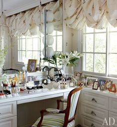Built in vanity table in a dressing room. So much storage and counter space