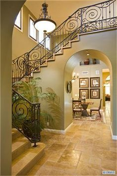 (railing, archway under the stairs, stone, framing/molding on stairs; pay attention to shadow shapes that could be created) house in Huntington Beach