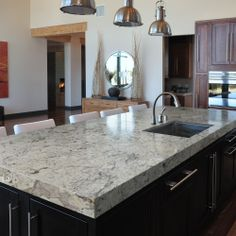 This is my fav countertop slab color combo. Whites/greys/blacks. The browns are overplayed.