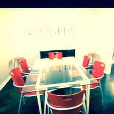 """The """"eat & drink"""" wall sign caught my eye! I also dig the red dining seats ~ from an Austin, TX home on HGTV's """"House Hunters"""""""