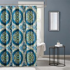 For a modern update to your space, the Madison Park Essentials Serenity Shower Curtain provides a whole new look with bold colors. An intricate medallion pattern repeats with shades of teal, green and blue playing up this oversized print.